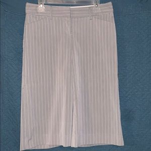 Gray pants with vertical, thin white stripes.
